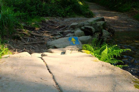 arrow on stone by creek