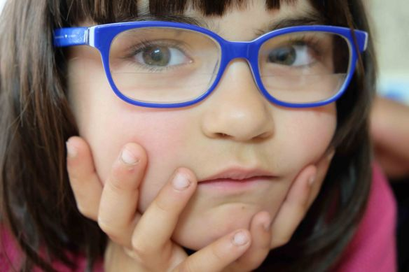 girl with blue specs