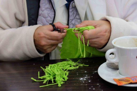 Jennifer cutting off tassels