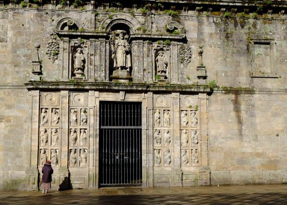 woman outside Cathedral wall