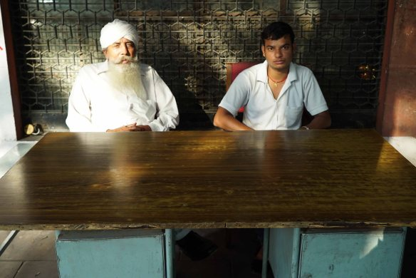 two sikhs sitting down