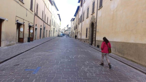 Jen walking down Gubbio street