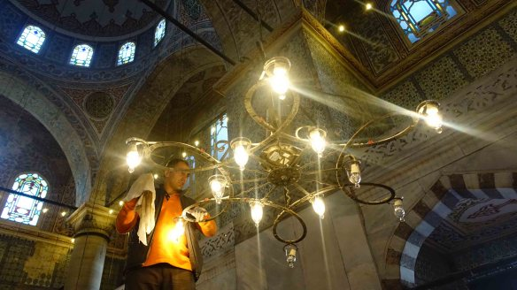 Changing lightbulb in Blue Mosque