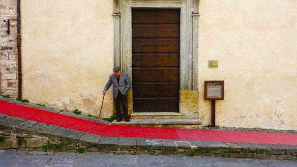 Man by door with carpet