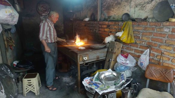 Man forging iron