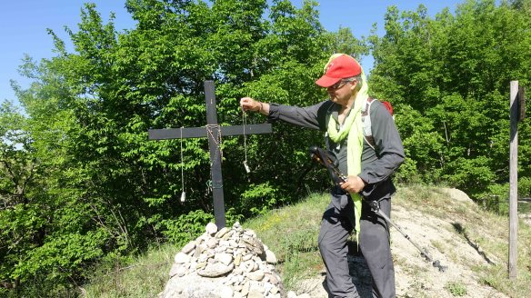 Putting banacle on cross