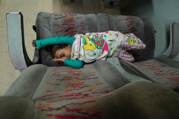 child sleeping on train
