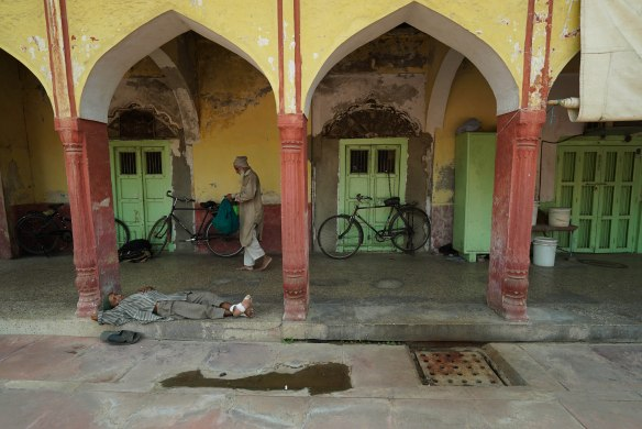 man resting in mosque