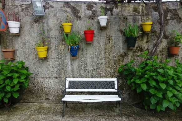 white chair with pots-1